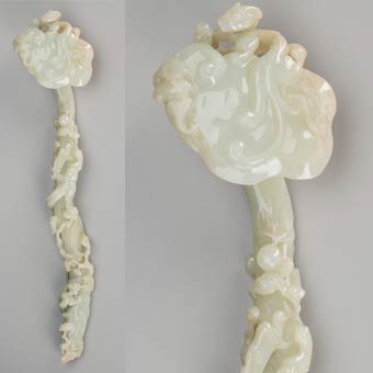 A Chinese Carved Pale Green Jade Ruyi Scepter