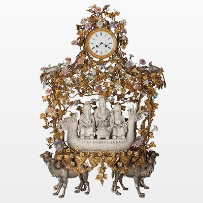 A Blanc-de-Chine, Gilt and Silvered Bronze Figural Clock