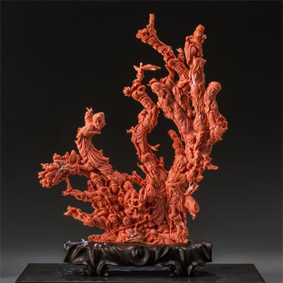 A Large Chinese Carved Coral Figural Group.