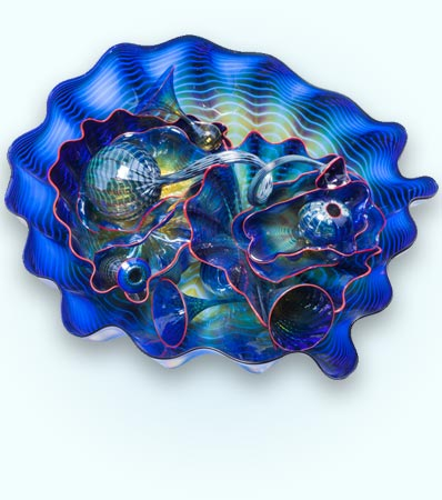 Dale Chihuly (American, b. 1941)Fourteen-Piece Cobalt Seaform Group with Red Lip Wrap, 1994