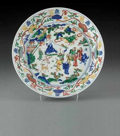 A Chinese Wucai 'Eight Immortals' Dish, Ming Dynasty, Wanli Period