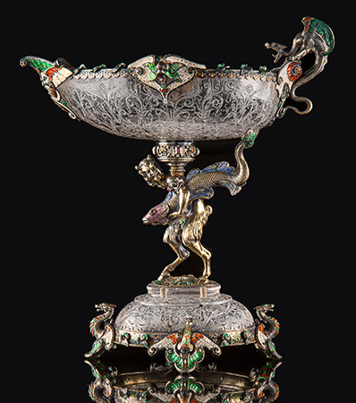 A Hermann Ratzersdorfer Gem-Set, Partial Gilt, and Enameled Silver-Mounted and Engraved Rock Crystal Figural Tazza