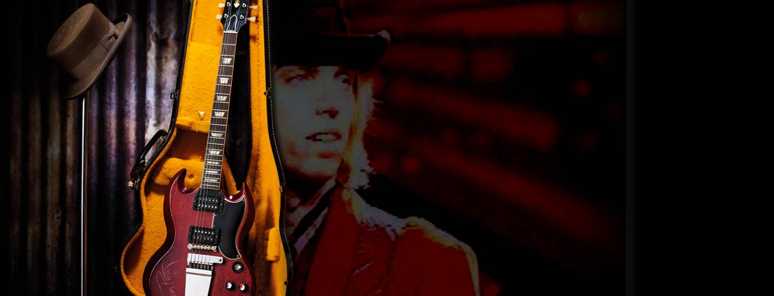 Tom Petty Stage Played 1965 Gibson SG Cherry Electric Guitar and Hat Worn on Stage and in Traveling Wilburys Music Videos.