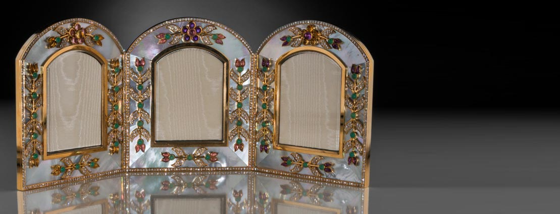 An Asprey 18K Gold, Diamond, Mother-of-Pearl, and Gemstone Tri-Fold Frame, London, 20th century