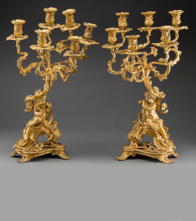 A Pair of Louis XVI-Style Gilt Bronze Six-Light Figural Candelabra