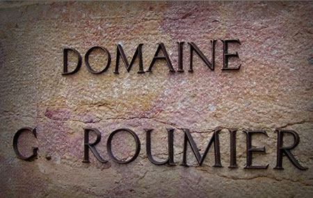 Georges Roumier was born in the Charolais region of France. In 1924 he married Genevieve Quanquin and she brought with her, as was customary back then, a dowry in the peculiar form of vineyards. The dowry vineyards were appropriately named Domaine G....